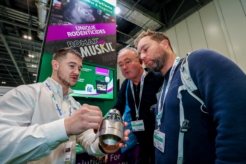 PestEx exhibitors showing of their pest prevention products to some UK vistors